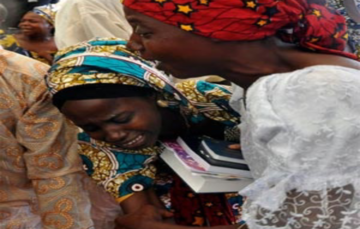 Nigeria's leaders meet Chibok girls, vows to free the rest