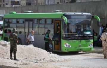 Syria's green buses now run on tears