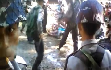 Officers detained in Myanmar after footage of police beating Rohingya Muslims