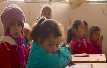 Syrian children return to school used as Daesh prison