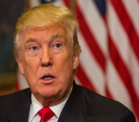 Hawaii judge puts Donald Trump's travel ban on hold