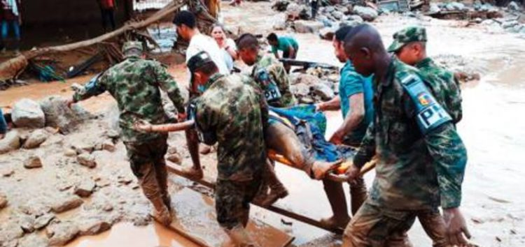 'I found a baby's hand': Gruesome search for Colombia mudslide survivors