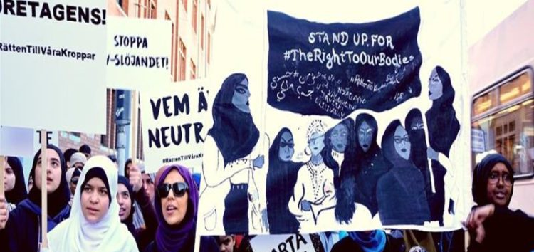 May Day marchers in Sweden took to the streets to back Muslim women's right to wear hijabs at work