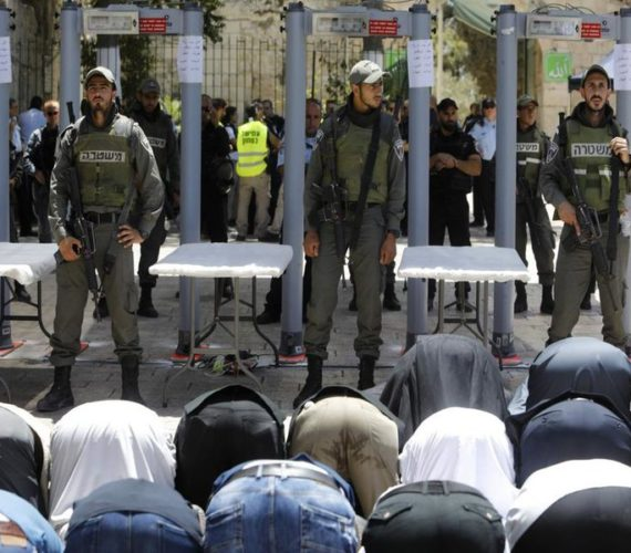 Palestinians reject Israel security measures in al-Aqsa, pray at an entrance to the compound