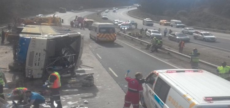 60 pupils injured as bus overturns