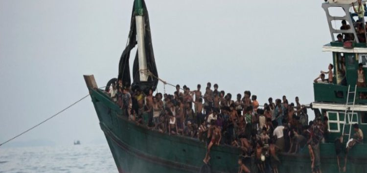 Many feared dead after boat carrying Rohingya capsizes in rough seas