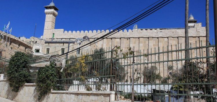 Settlers place menorah on Ibrahimi Mosque in Hebron