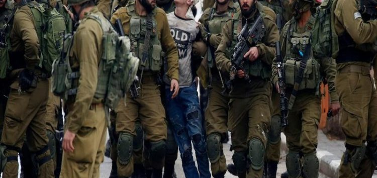 Photo of Palestinian teen being manhandled by Israeli soldiers goes viral, has become a symbol of ongoing protests against US President Donald Trump's Jerusalem decision