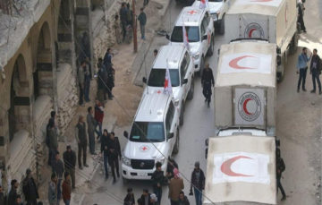 Aid convoy reaches Ghouta but retreats after shelling