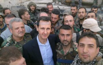 Assad poses for photos with Syrian troops in Eastern Ghouta as civilian death toll rises