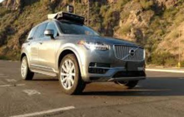 Uber halts self-driving cars after pedestrian is killed