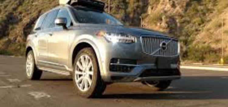 Uber halts self-driving cars after pedestrian is killed