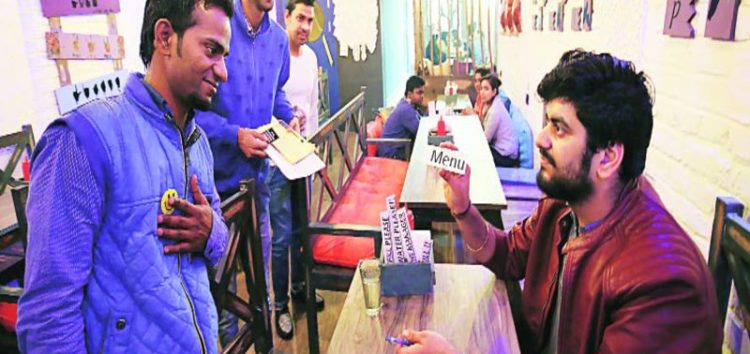 Indian restaurant run by differently-abled staff using sign language