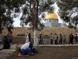 Banned worshippers pray at Al-Aqsa Mosque gates in defiance of Israeli policy