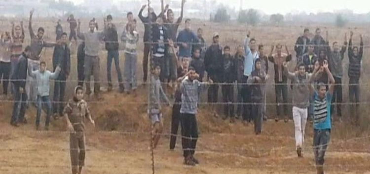 Palestinians preparing to cross the fence separating Gaza from Israel