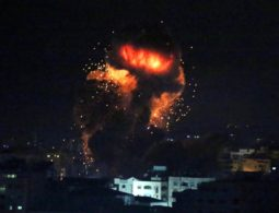 Israel bombs Gaza, positions troops after rocket attack near Tel Aviv