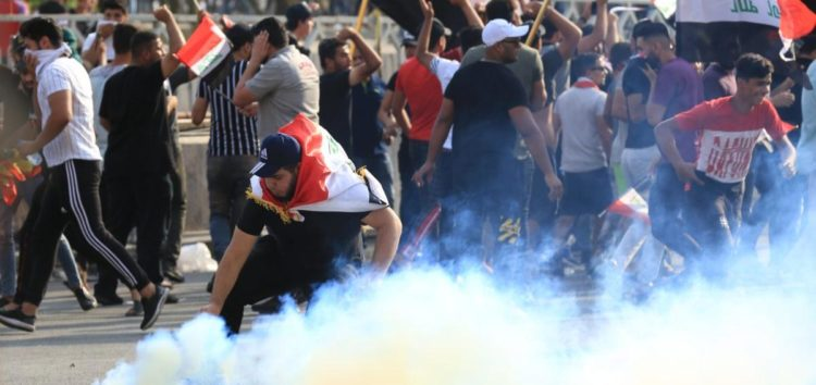 1 killed, 200 wounded in Iraqi protests after police open fire