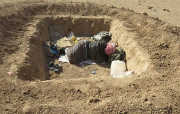 Mosul refugees sleeping in 'graves'